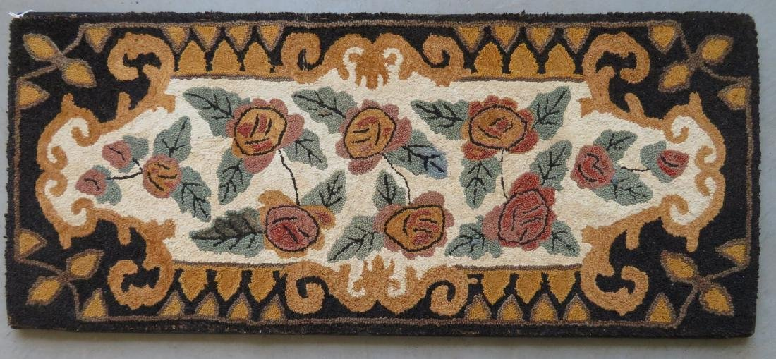 Mounted hooked rug in an oak leaf and acorn pattern,
