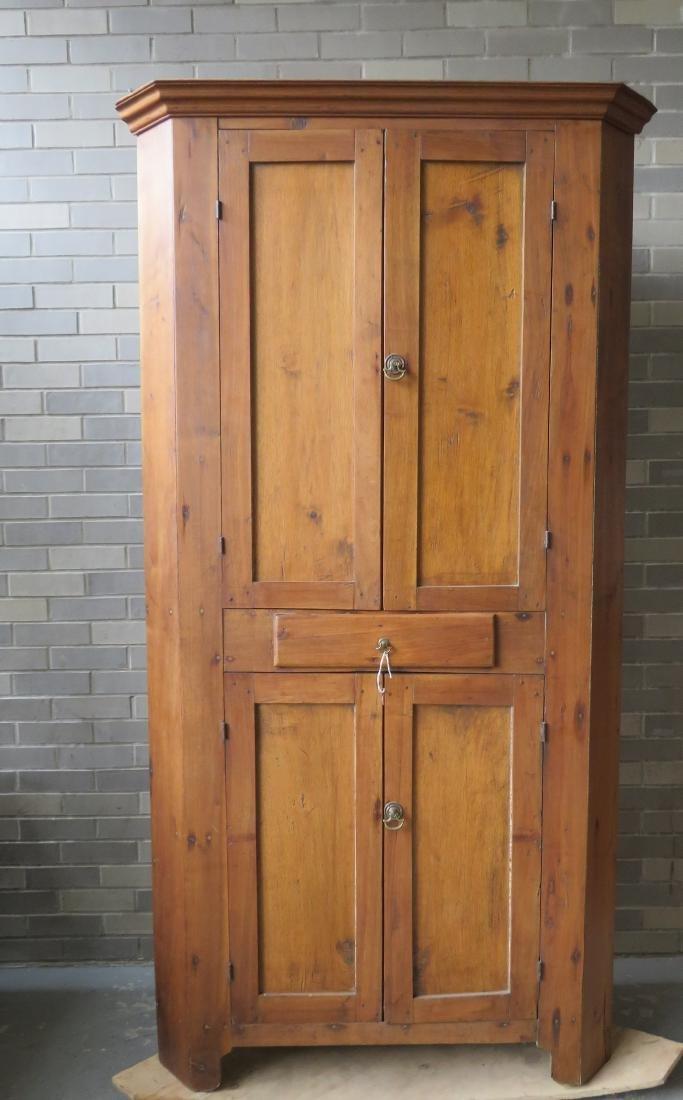 Primitive walnut corner cupboard having 2 doors over 1