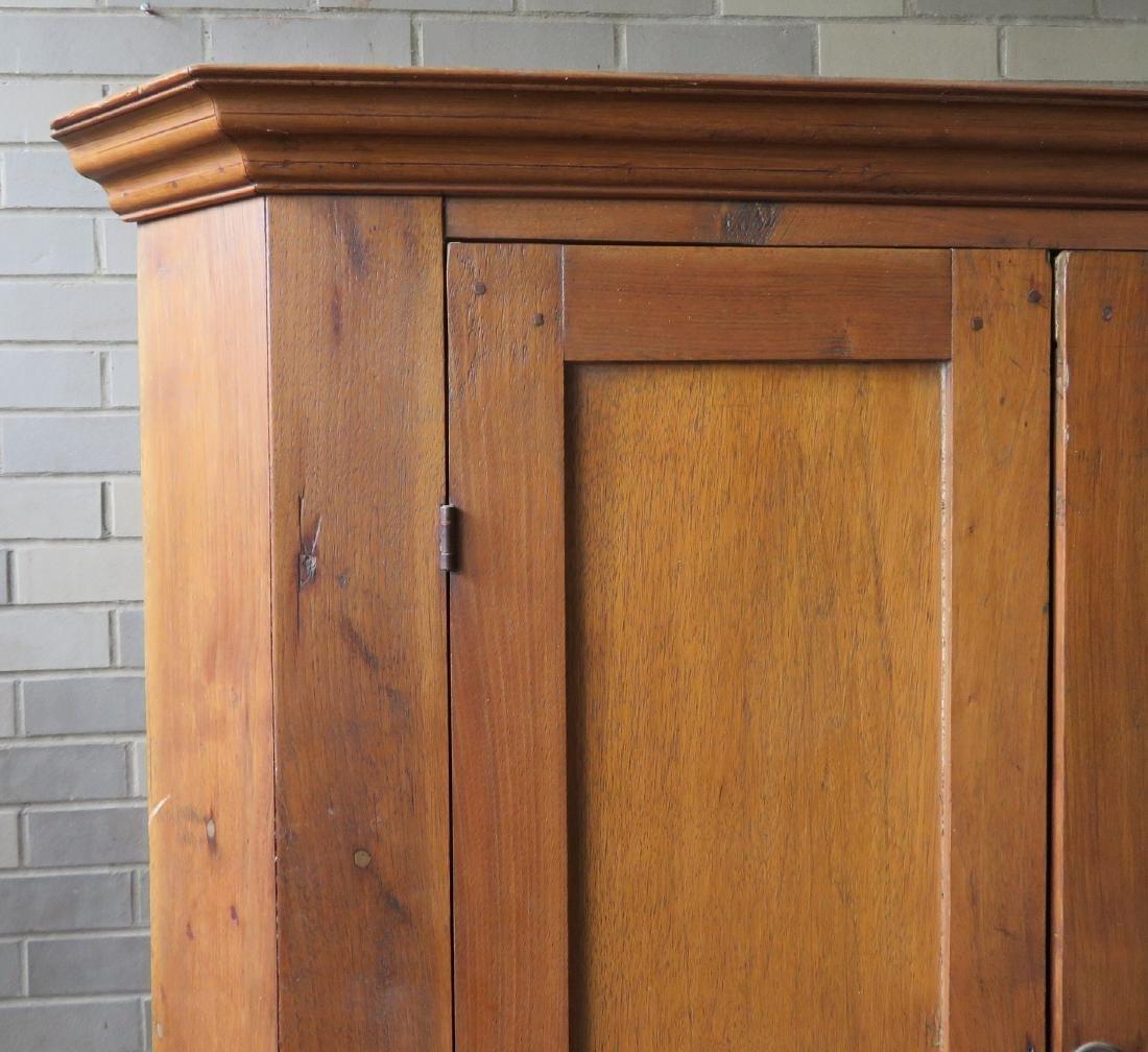 Primitive walnut corner cupboard having 2 doors over 1 - 2