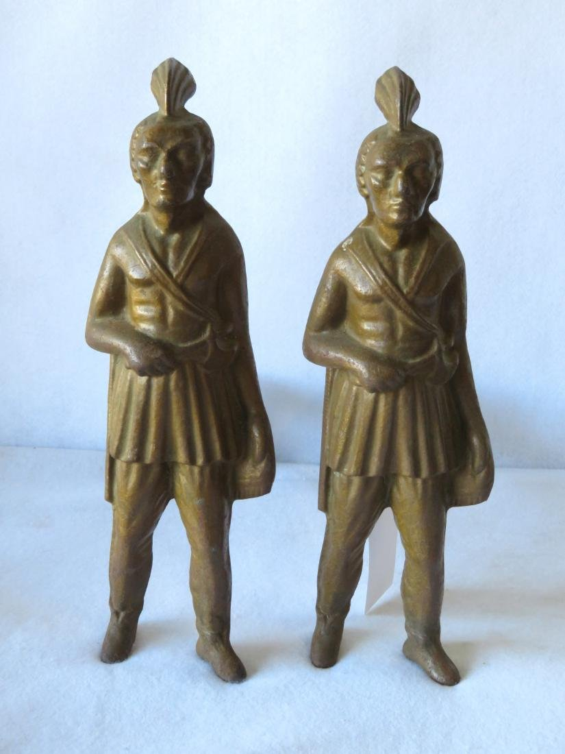 A rare pair of figural cast iron Native American