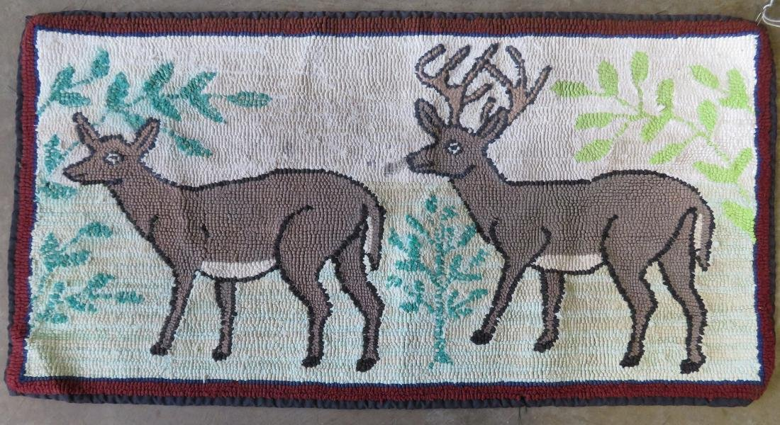 Hooked rug of 2 standing deer including a stag and doe,