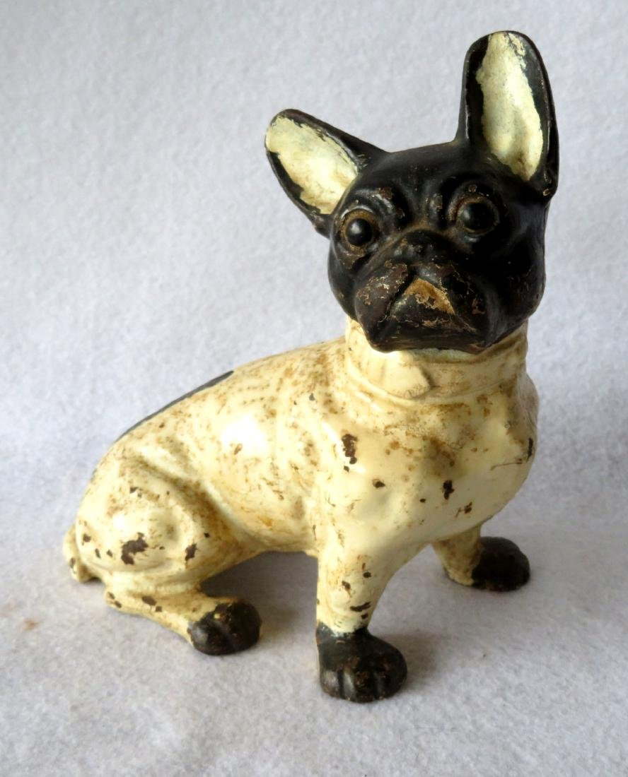 Cast iron Boston Bull seated puppy door stop in an