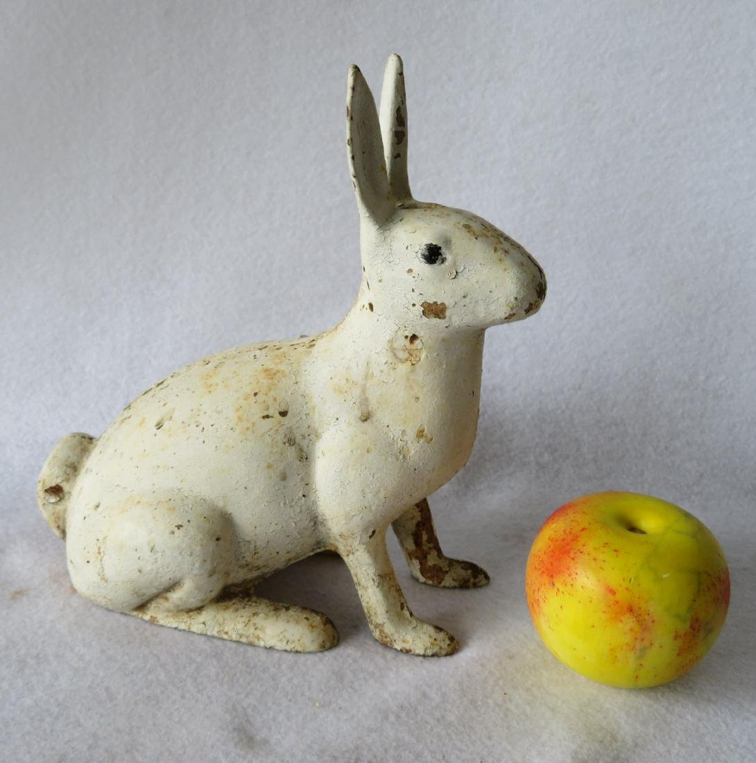 "Cast iron rabbit door stop in old white paint - 9.25""H. - 2"