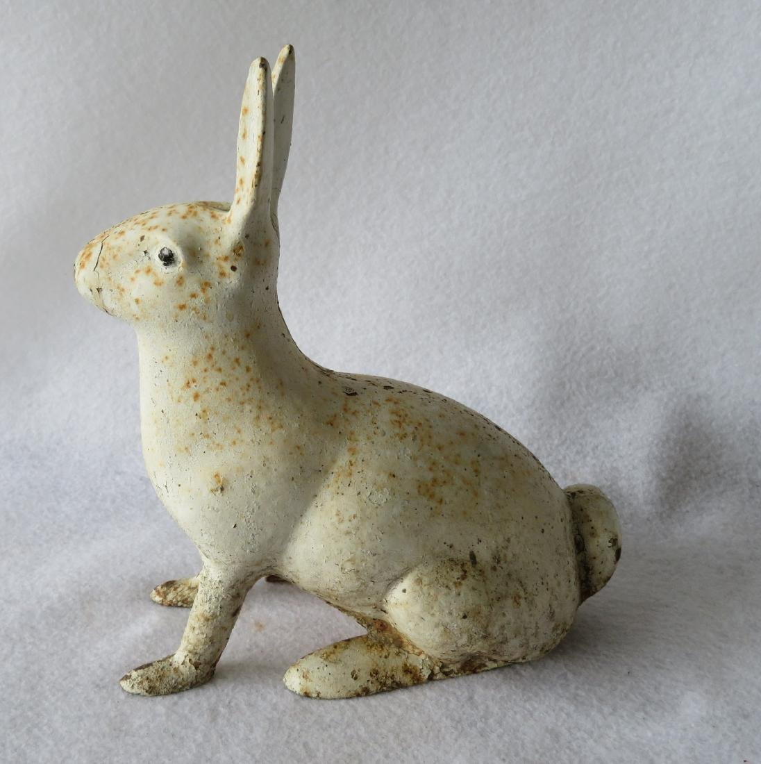 "Cast iron rabbit door stop in old white paint - 9.25""H. - 3"