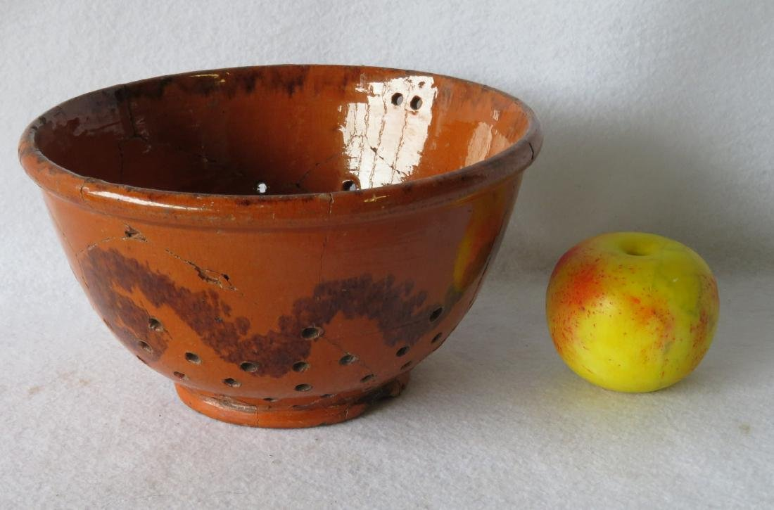 American Redware colander with wavy manganese