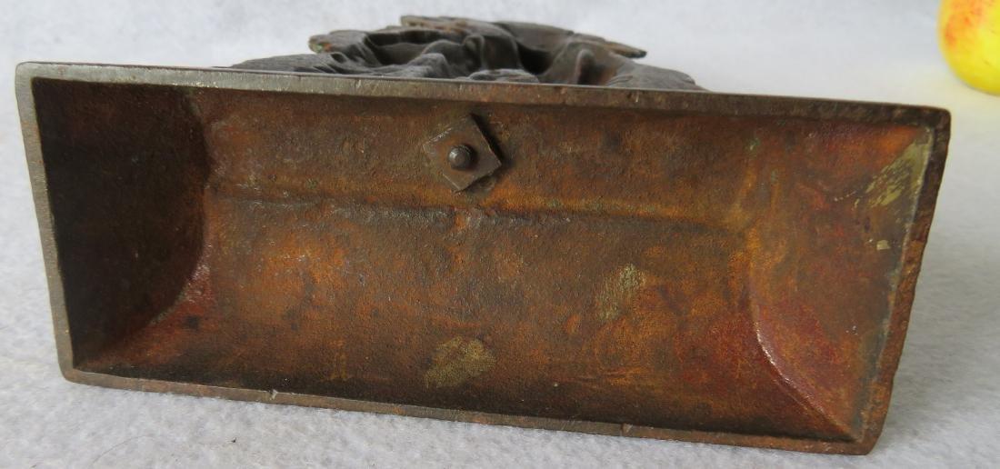 "Cast iron door stop of a Minuteman, marked ""1776 ""on - 5"