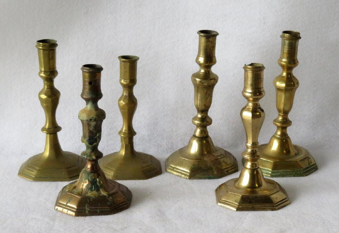 Six various 18th century French brass candlesticks