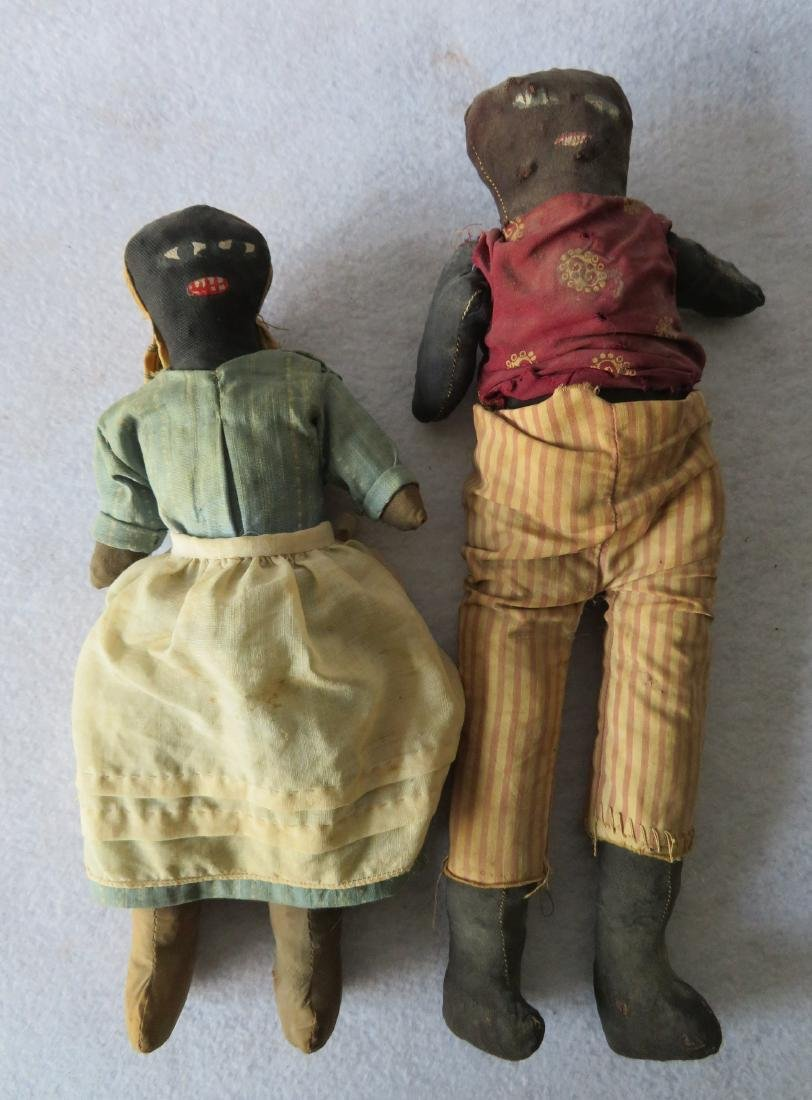 Two hand made golliwog dolls, both straw filled, and