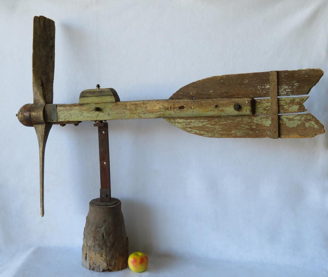 Large primitive propeller shaped barn whirligig with