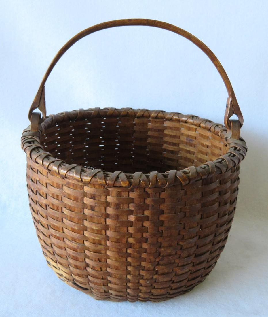 A very fine New England swing handle basket with double