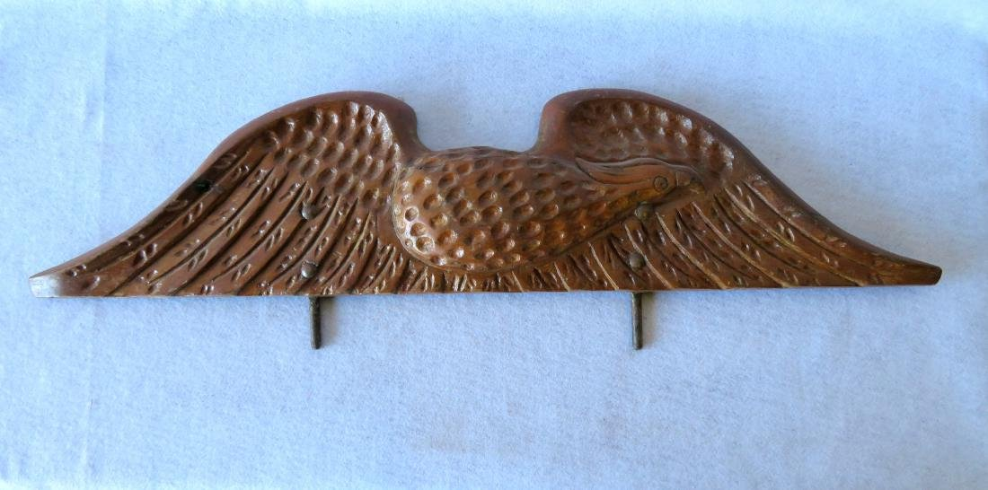 Hand carved wooden spread wing eagle wall plaque in an