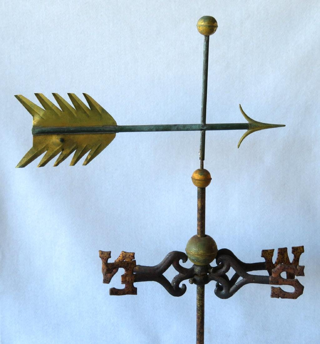 A sheet copper arrow weathervane with zinc tip and