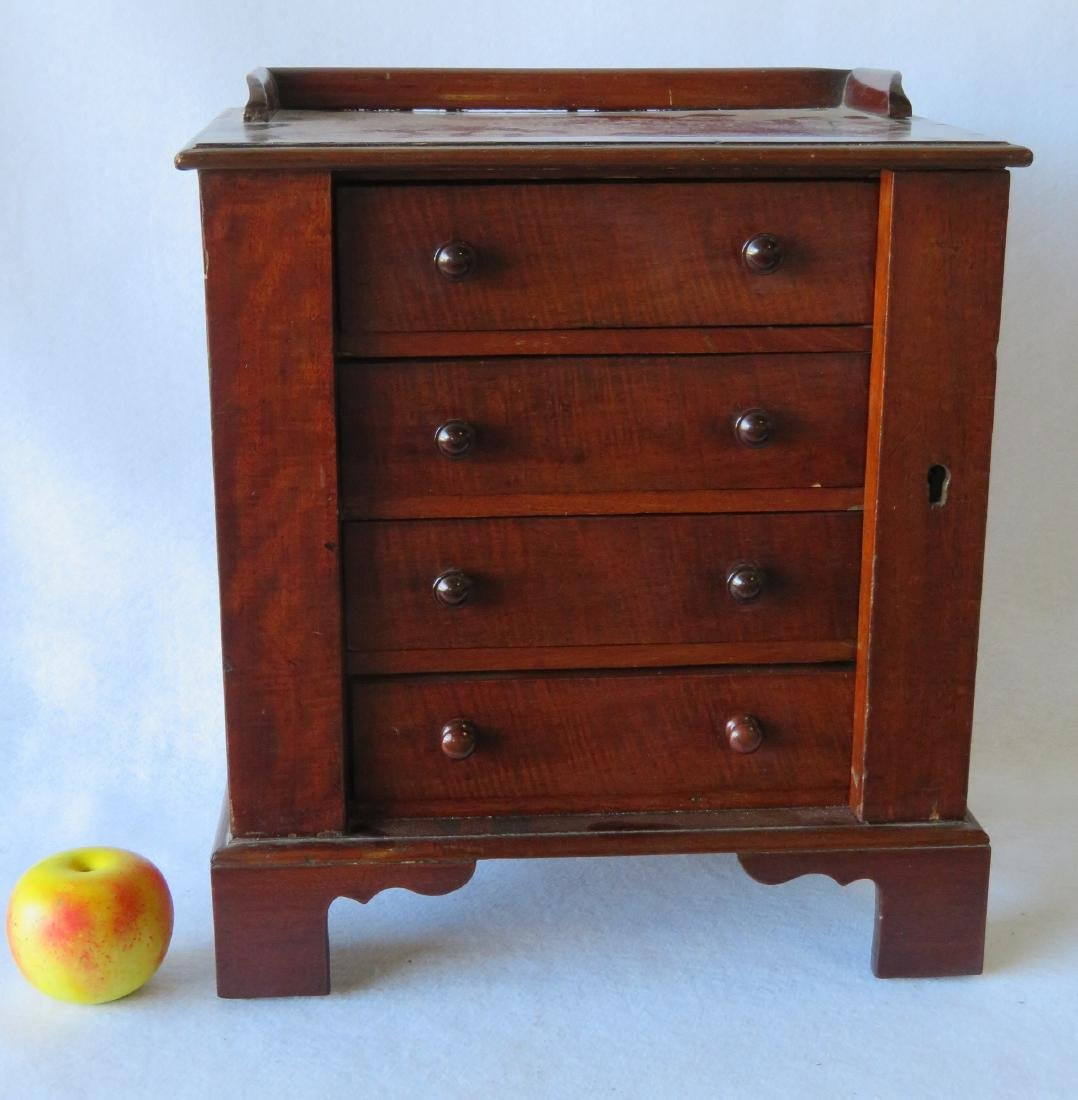 Miniature mahogany side lock chest in the Chippendale