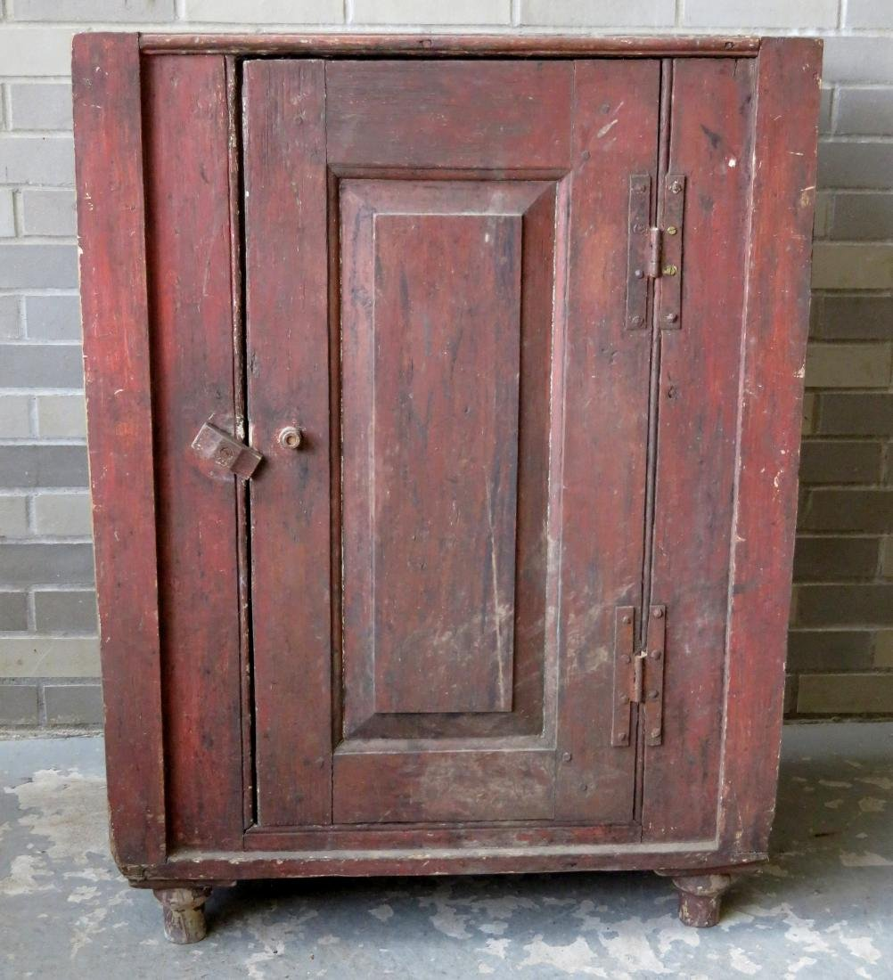 A small single door Hudson Valley floor cupboard with a