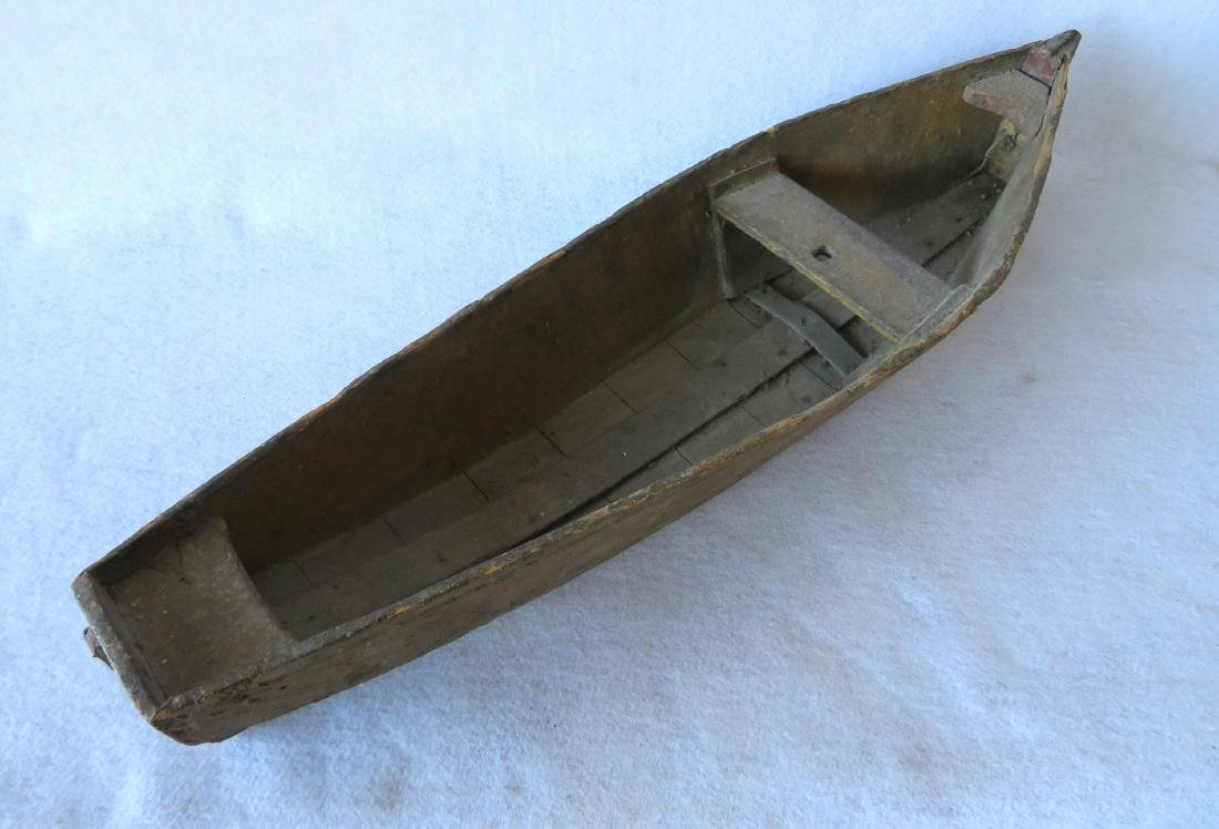 Two handmade wooden rowboats, both with traces of - 4
