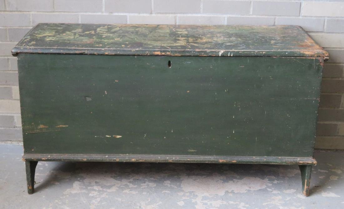 Early blanket box in old green paint over original red