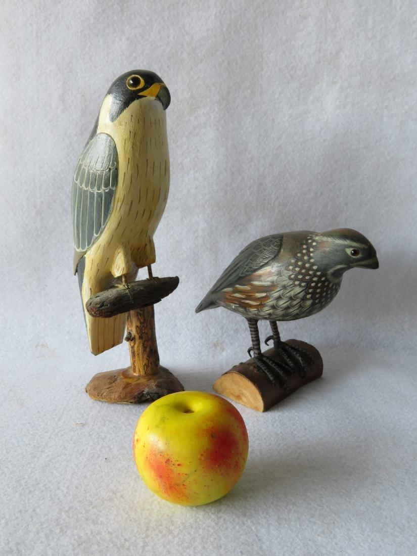 Two folkart bird sculptures standing on perches - 2