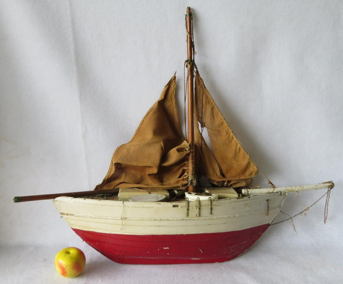Early painted pond sailboat with some loose parts