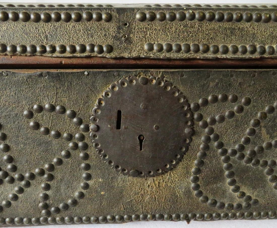 An early leather covered wooden trunk decorated with - 2