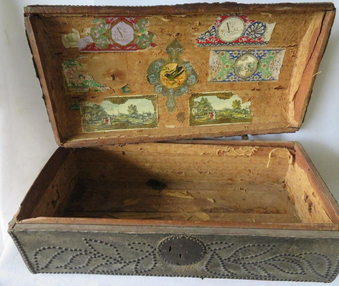 An early leather covered wooden trunk decorated with - 3