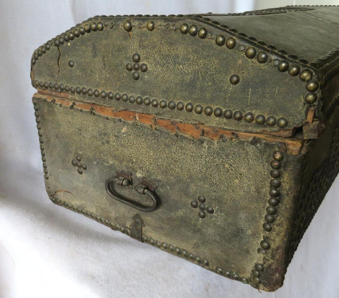 An early leather covered wooden trunk decorated with - 4