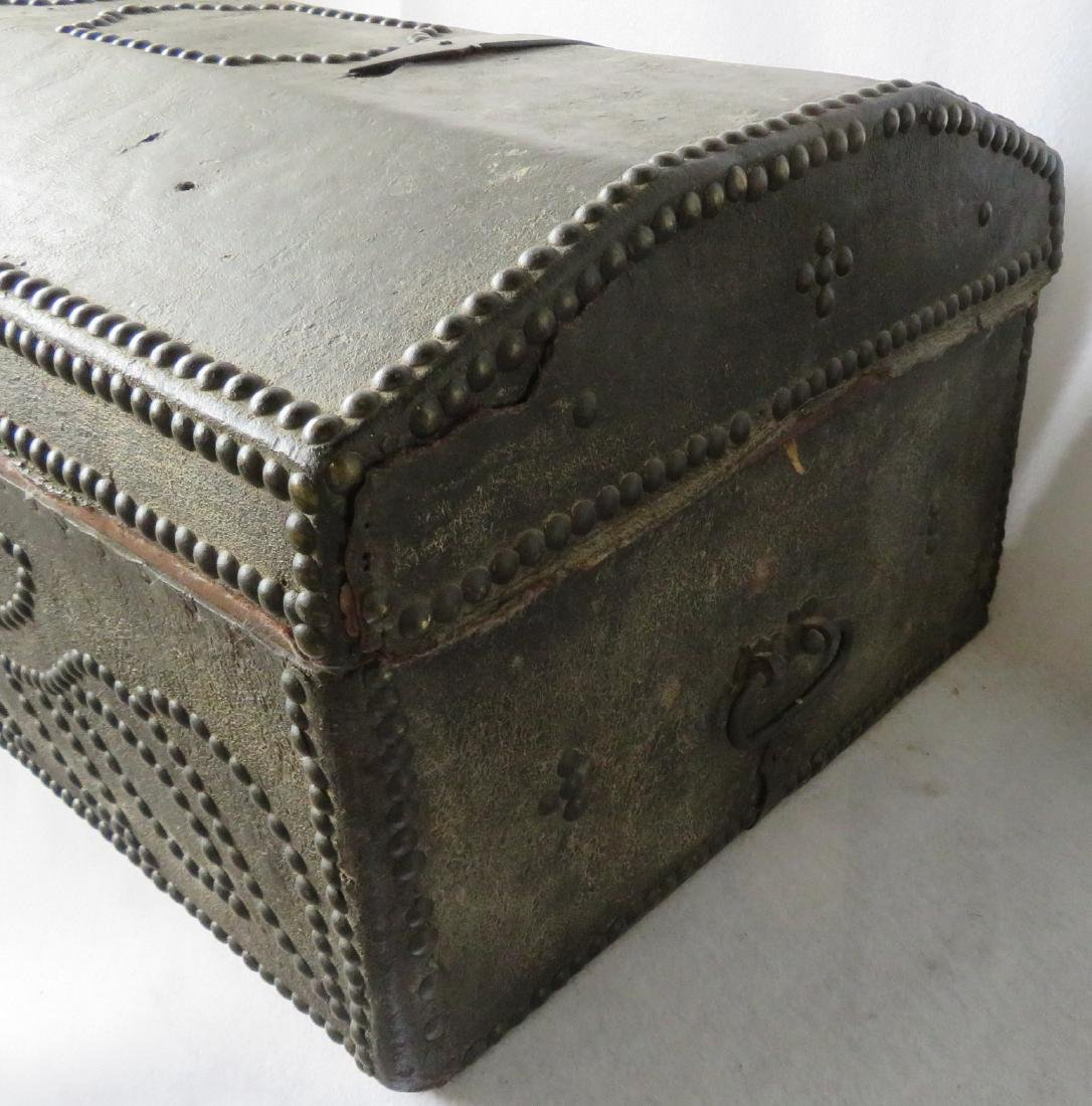 An early leather covered wooden trunk decorated with - 5