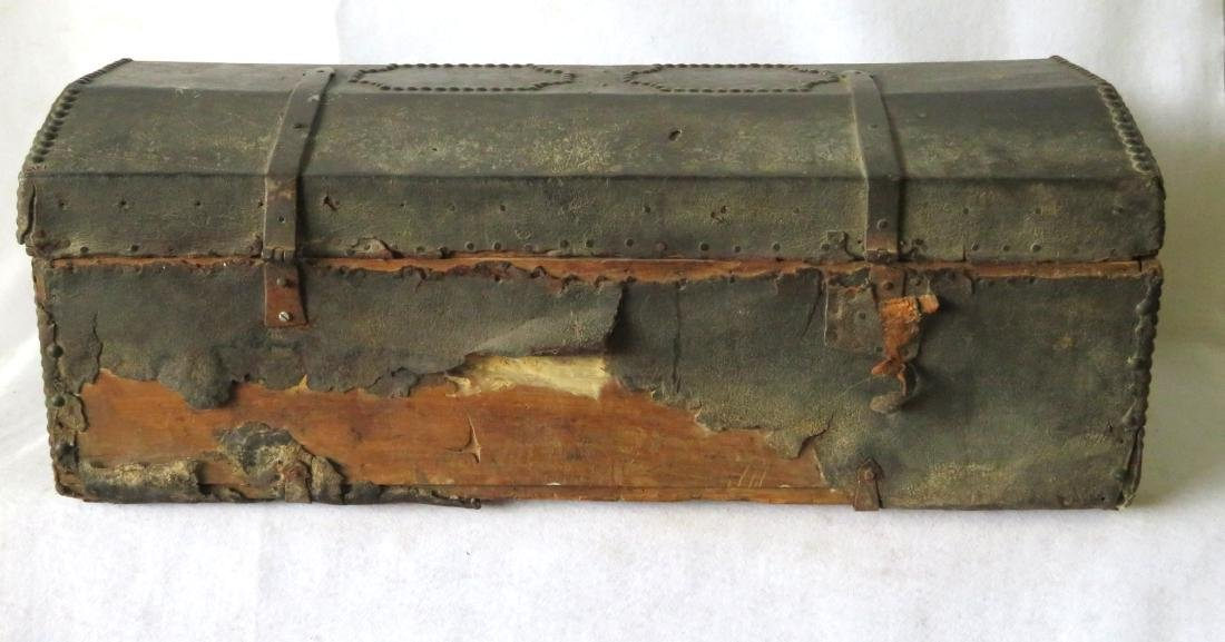 An early leather covered wooden trunk decorated with - 6