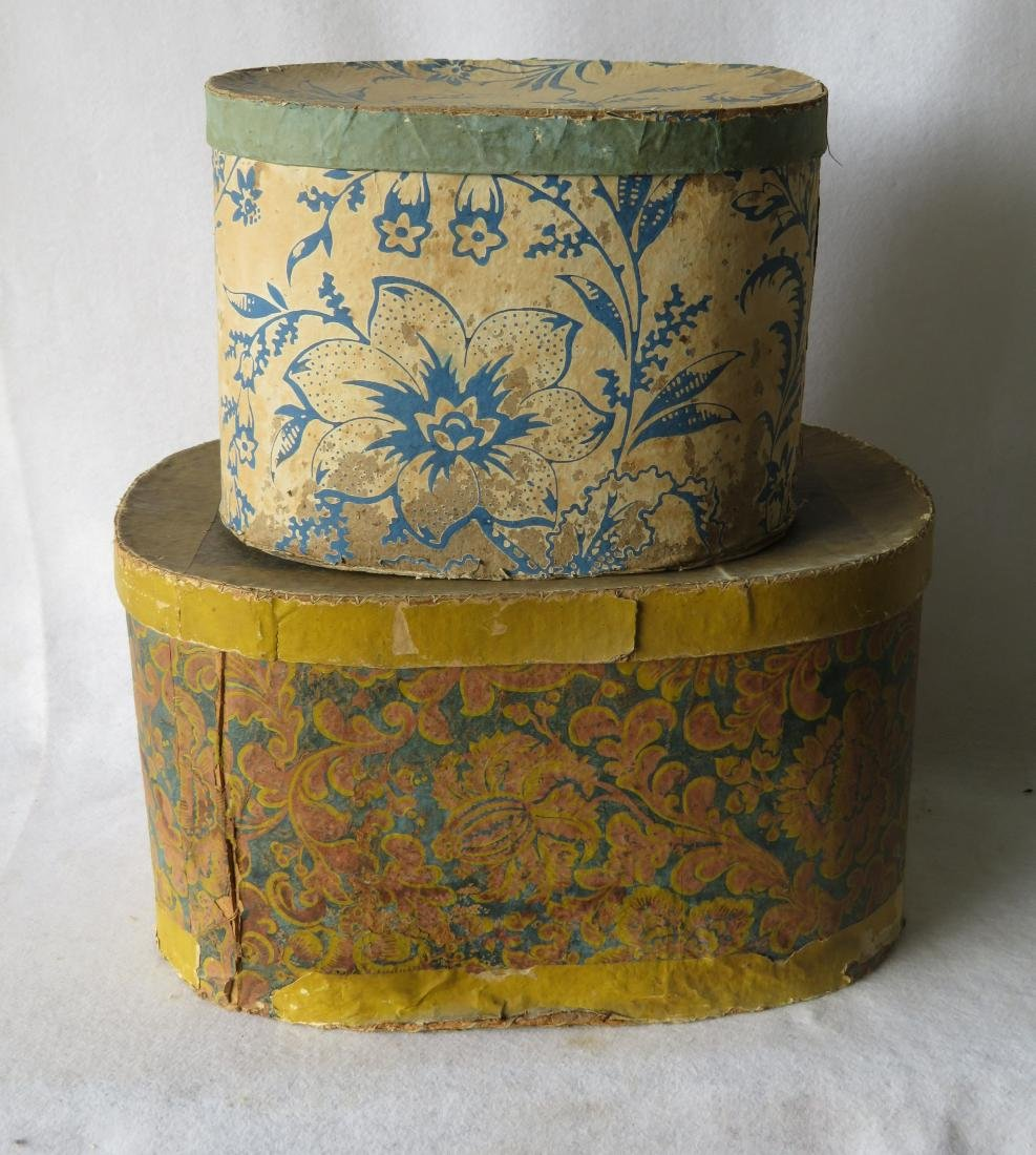 Two colorful 19th century wall paper band boxes