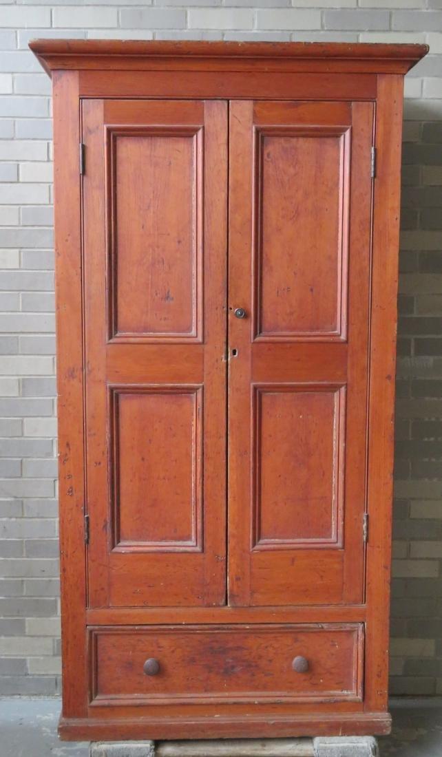 Pine cupboard having 2 paneled doors over a long drawer