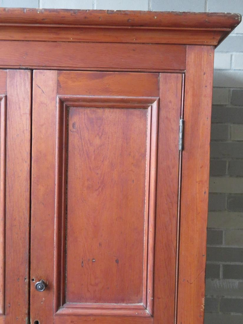 Pine cupboard having 2 paneled doors over a long drawer - 2