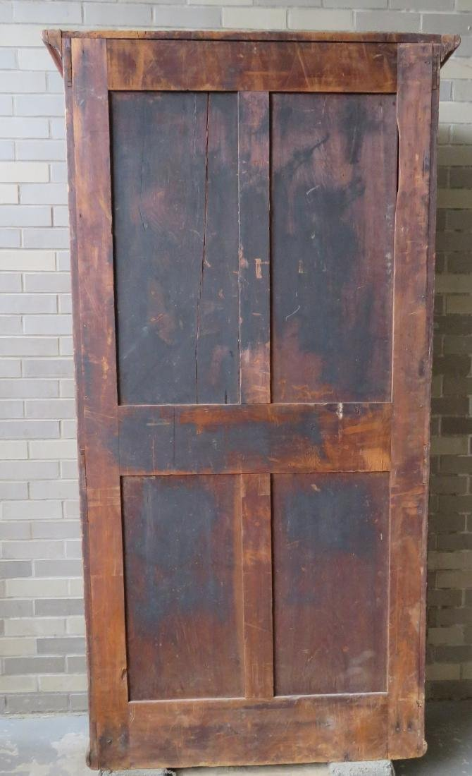 Pine cupboard having 2 paneled doors over a long drawer - 4