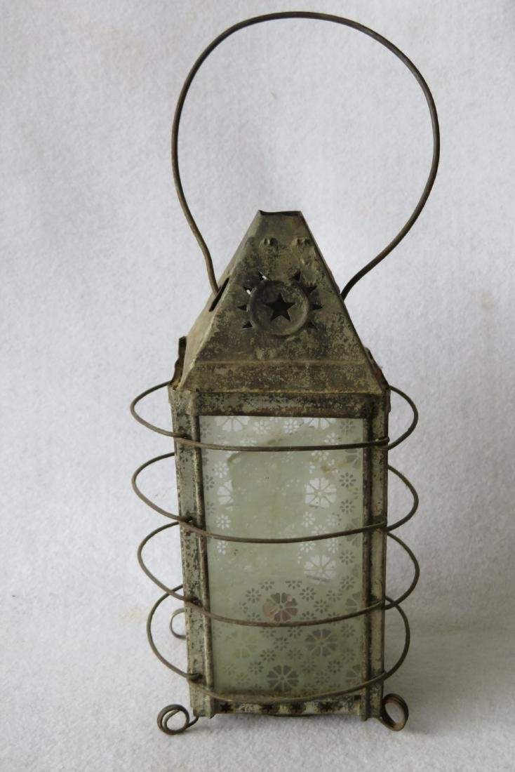 An early tin candle lantern with bale handle and having