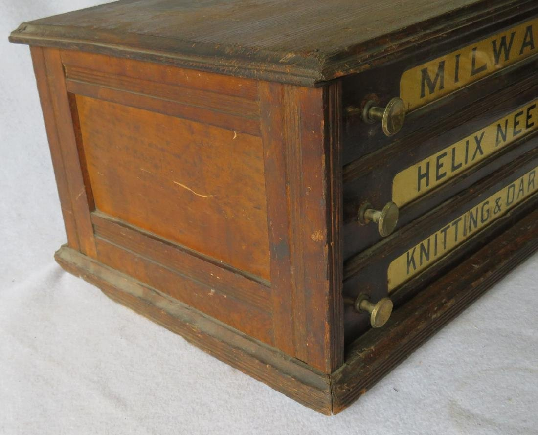 Three drawer oak spool cabinet marked on drawers - 4
