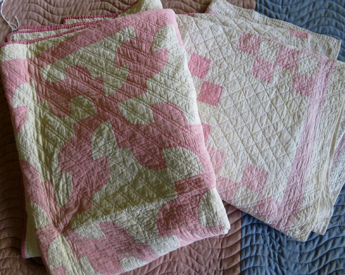 Two pink and white patchwork quilts: Drunkard's Path