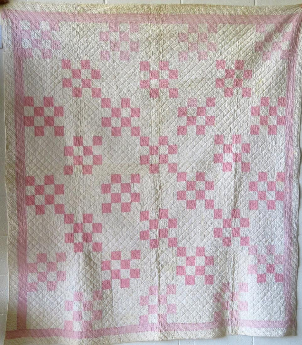 Two pink and white patchwork quilts: Drunkard's Path - 2