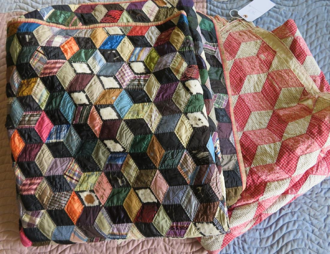 Two patchwork quilts in the rolling block pattern: 1)