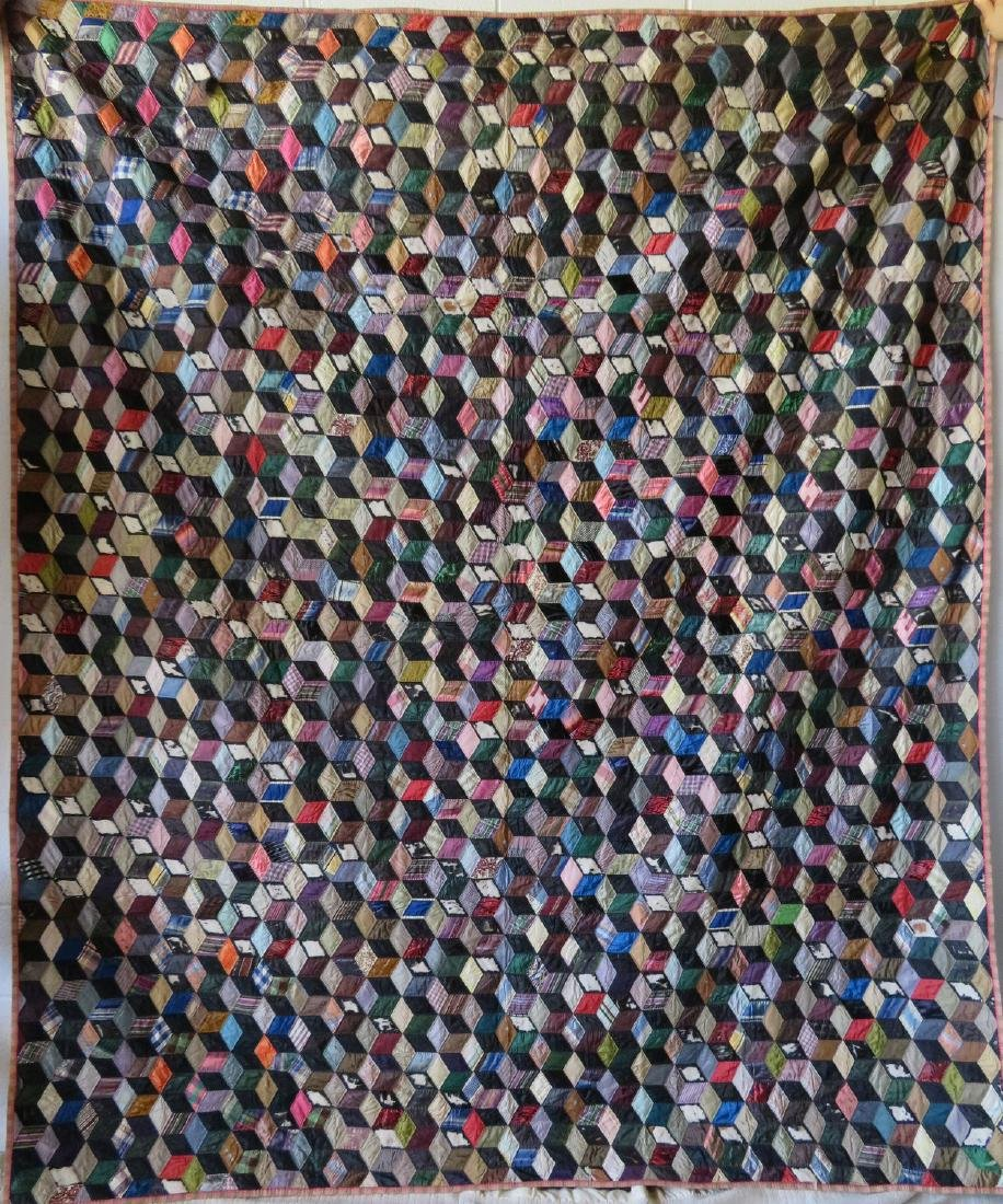 Two patchwork quilts in the rolling block pattern: 1) - 2