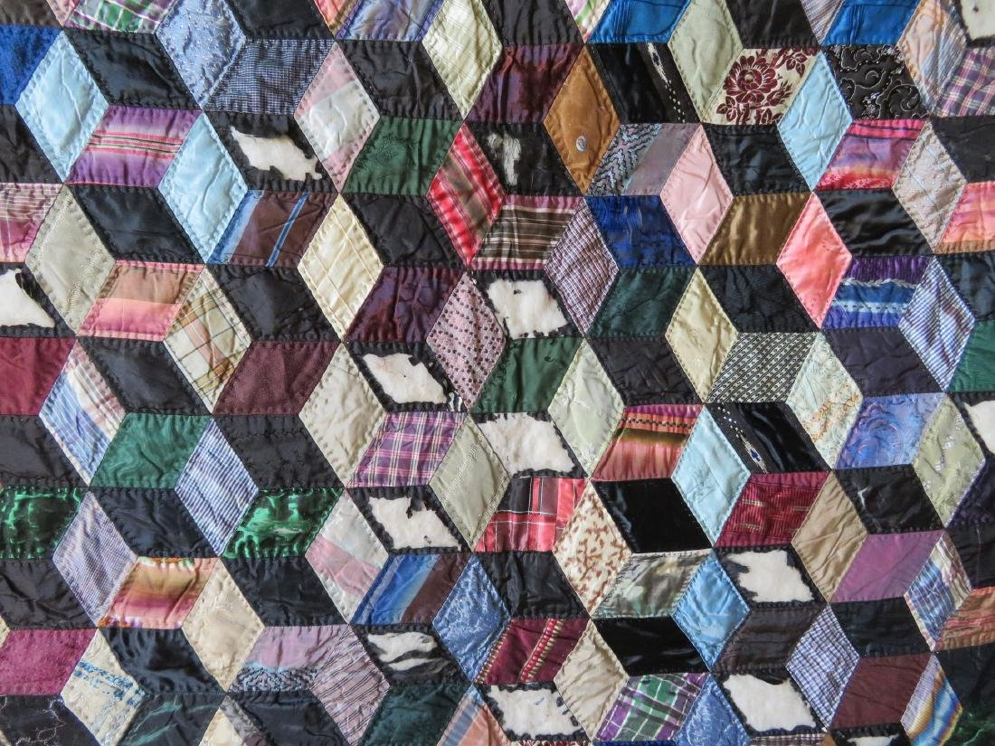 Two patchwork quilts in the rolling block pattern: 1) - 3