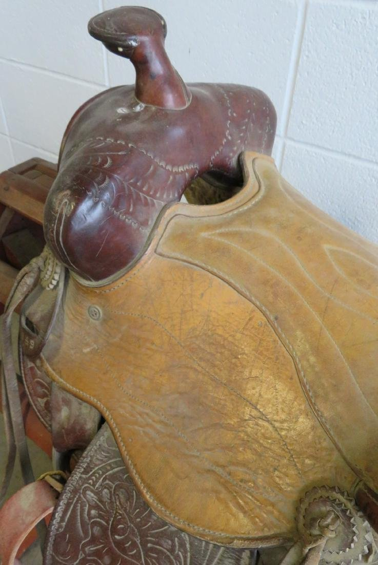 Two tooled leather western saddles with girths - both - 8