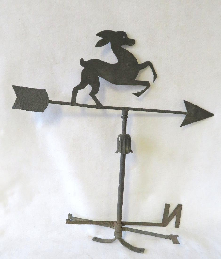 Sheet iron silhouette stylized leaping deer mounted on