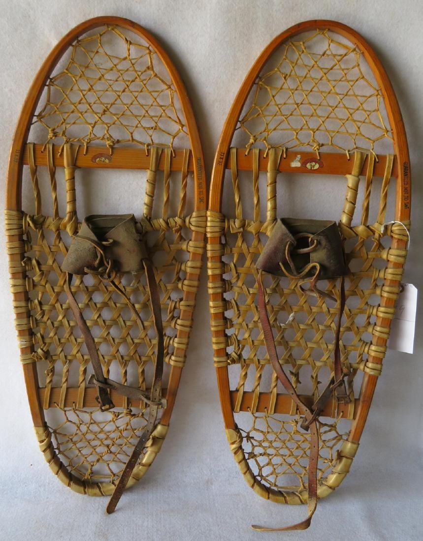 """Pair of hickory snow shoes signed """"Northland"""" - 13"""" x"""