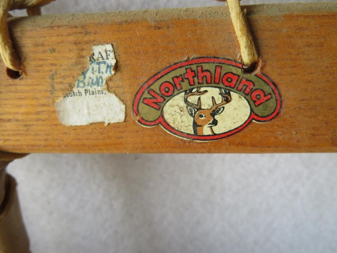 """Pair of hickory snow shoes signed """"Northland"""" - 13"""" x - 2"""