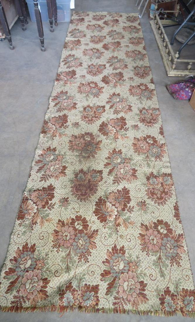 An ingrain carpet runner with a floral pattern, 11' 9""