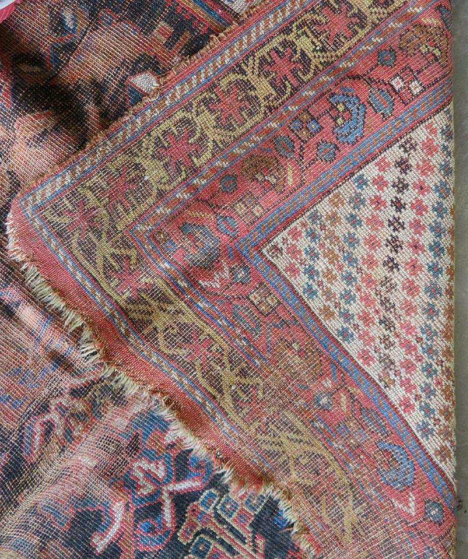 Two worn 19th century oriental scatter rugs with some - 4