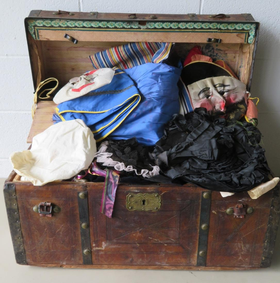 Stagecoach trunk with vintage textiles and bonnets -