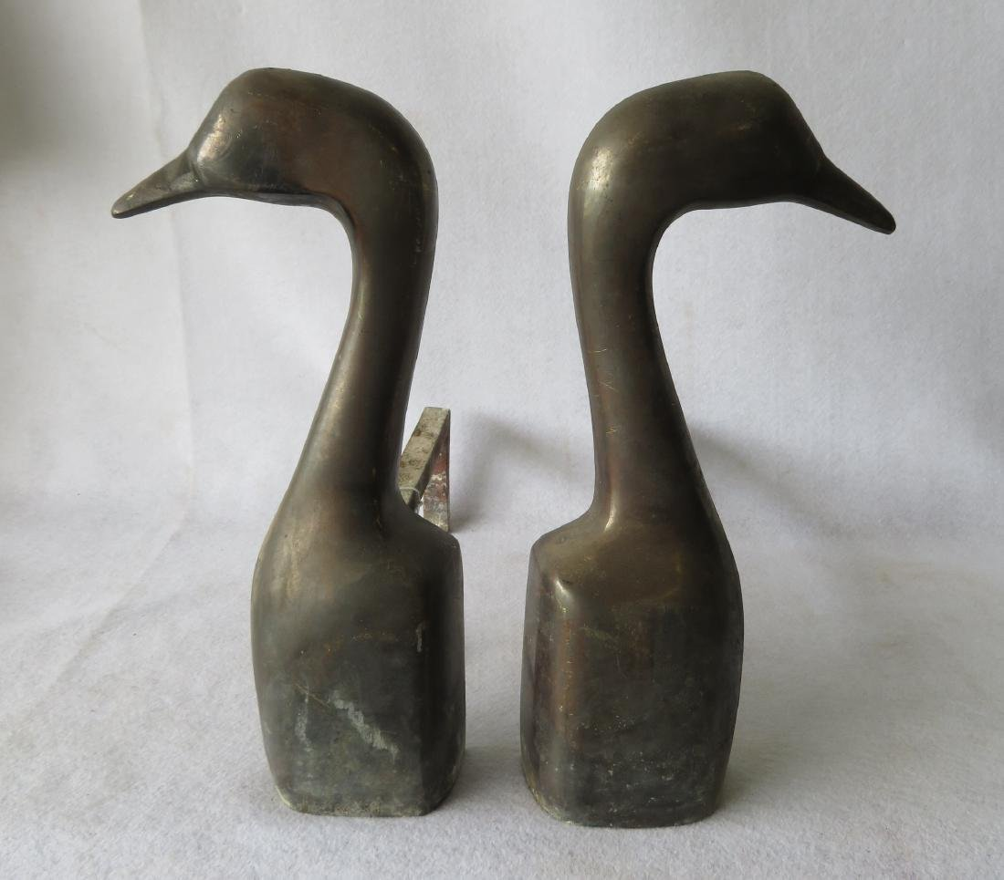 Pair of goose head form bronze andirons signed Kortz