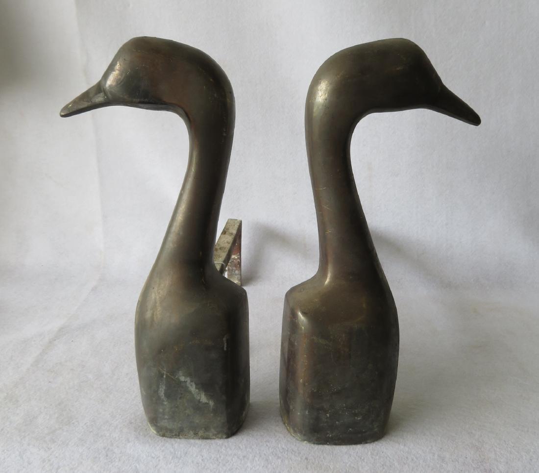 Pair of goose head form bronze andirons signed Kortz