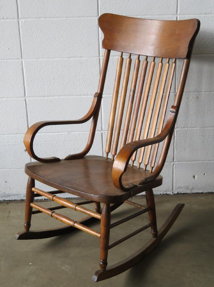 Oak rocker with 8 vertical spindles. Late 19th to early