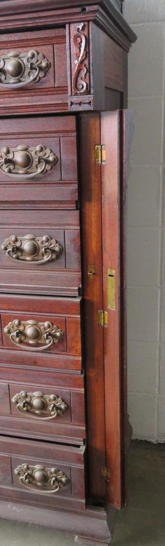 Black walnut side lock chest having a carved wooden - 4