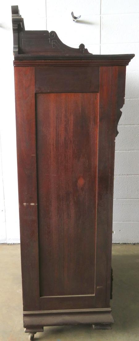 Black walnut side lock chest having a carved wooden - 5